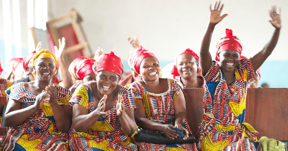 Photo of women celebrating in church | Accelerating Bible Translation