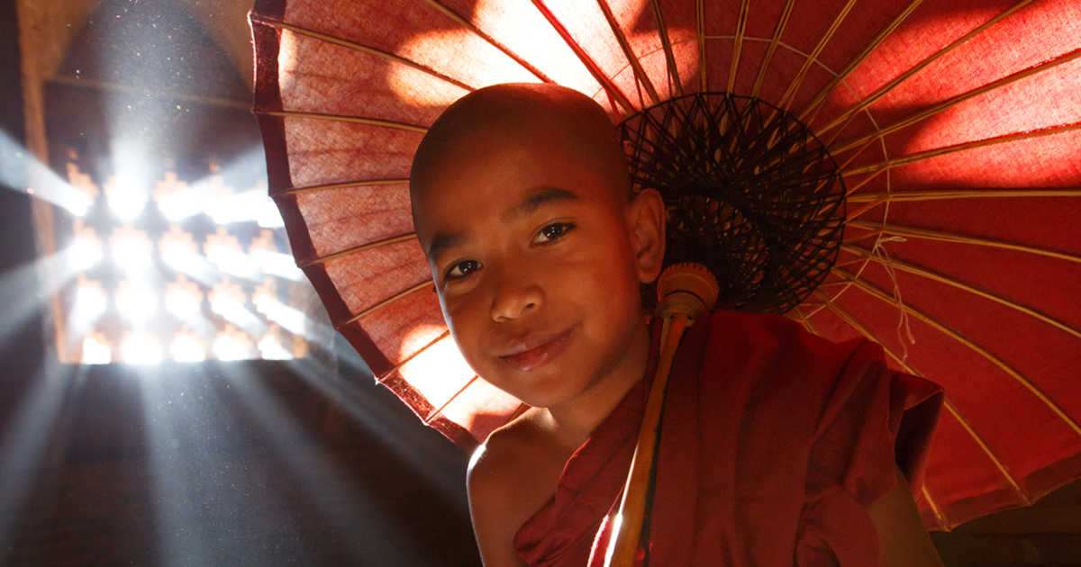 Boy in Light under Parasol in Asia